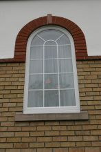 UPVC Astral Bar Ovolo Arched Window